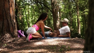 Brunette bimbo pleasuring black dude in the woods