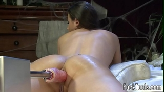 Busty non-professional fucked by fake penis machine